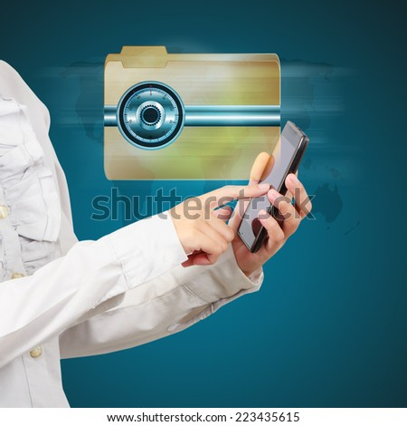 Business hand show a locked folder on smartphone. Data security concept. - stock photo