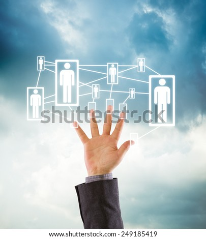 Business hand showing five fingers connected to business team or social network on dramatic background - stock photo