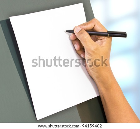 Business hand take a note on blank paper - stock photo