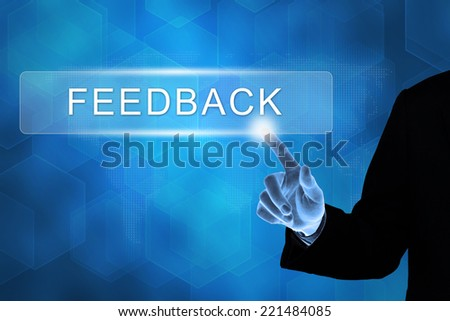 business hand touching feedback button on a touch screen interface  - stock photo