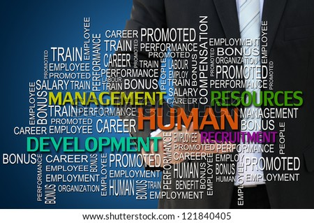 Business hand touching human management concept - stock photo