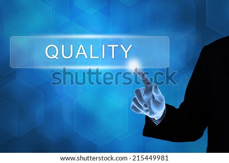 business hand touching quality button on a touch screen interface  - stock photo