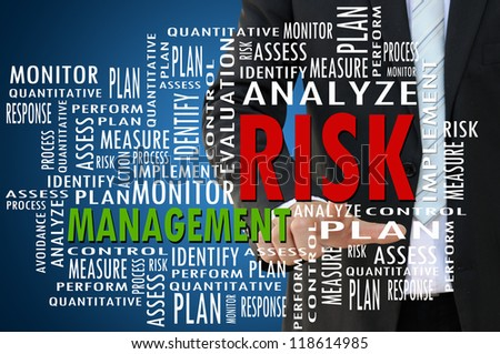 Business hand with risk management concept - stock photo