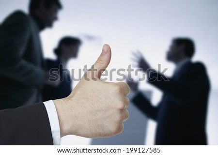 Business hand with thumb up on background business people - stock photo