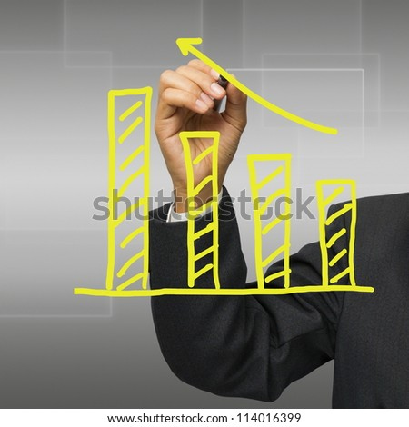Business hand writing a yellow graph - stock photo