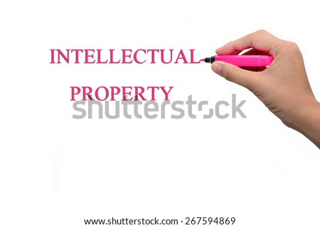 Business hand writing INTELLECTUAL PROPERTY  - stock photo