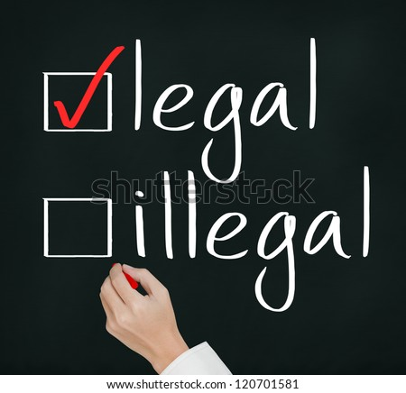 business hand writing red check mark for legal selection - stock photo