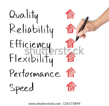 business hand writing rising reliability, quality, efficiency, flexibility, performance and speed - stock photo