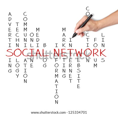 business hand writing social network concept by crossword - stock photo