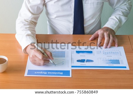 business hands checking a data paper