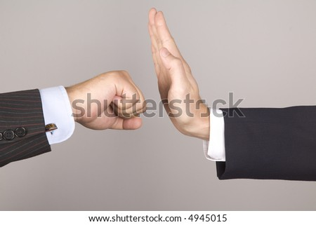 Business hands fight on white background with clipping path. - stock photo