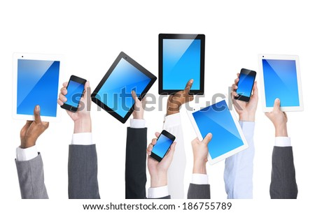 Business Hands Holding Electronic Devices - stock photo