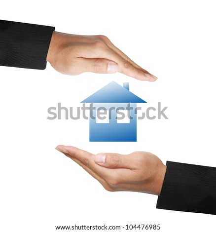 business hands protecting a house - stock photo