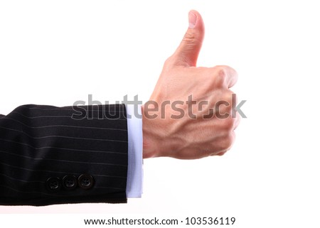 Business hands showing thumbs up sign against white background - stock photo