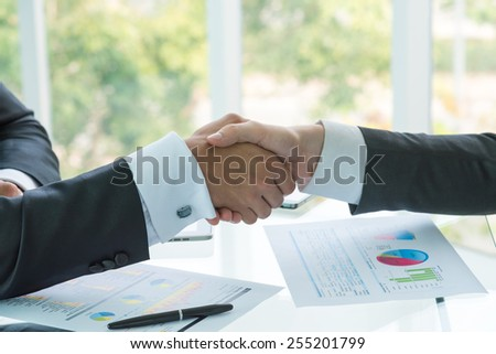 Business handshake - stock photo