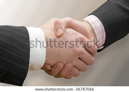 Business handshake - stock photo