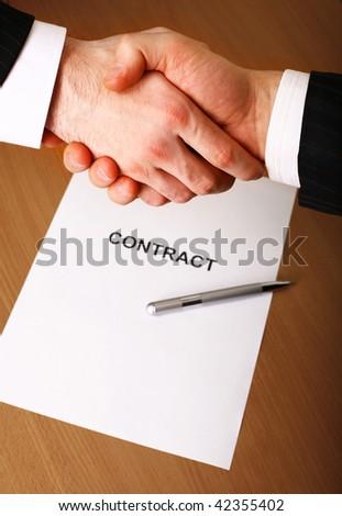 Business handshake. - stock photo