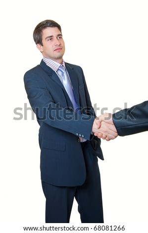 Business handshake. A trendy young handsome businessman with a blue tie and striped is shaking hands with another businessman over white background