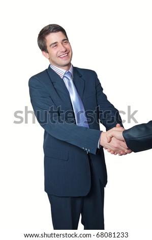 Business handshake. A trendy young smiling handsome businessman with a blue tie and striped is shaking both hands with another businessman over white background - stock photo