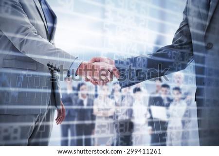 Business handshake against stocks and shares - stock photo