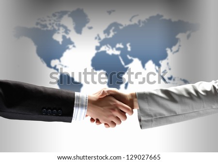 business handshake against white background with map image