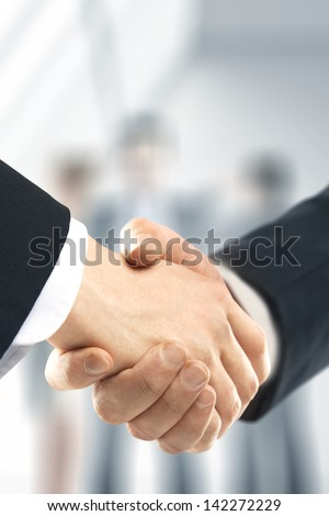 business handshake and people background - stock photo