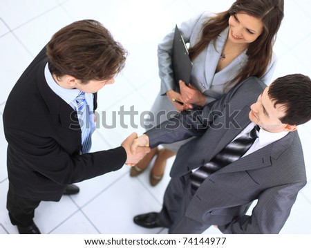 Business handshake and trust taken from above - stock photo