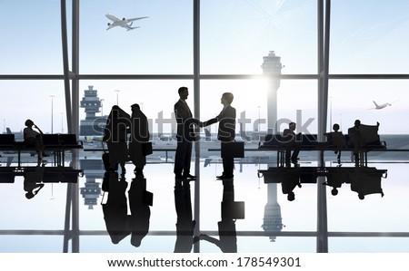 Business Handshake at Airport - stock photo