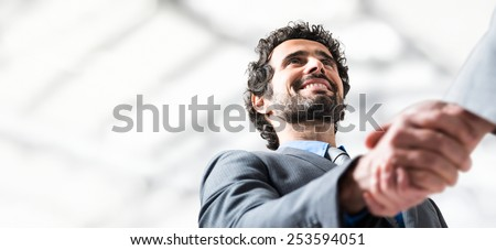 Business handshake. Businessman giving an handshake to close the deal. Lots of copyspace - stock photo