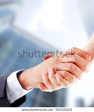 Business handshake closing an important deal - stock photo