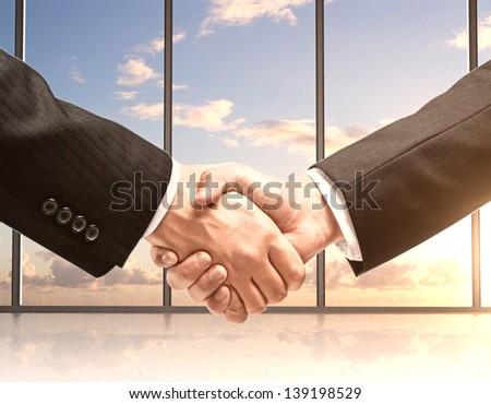 business handshake in office - stock photo