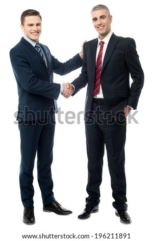 Business handshake of two successful partners - stock photo