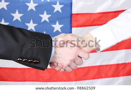 Business handshake on american flag background