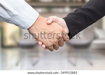 Business handshake on blur background