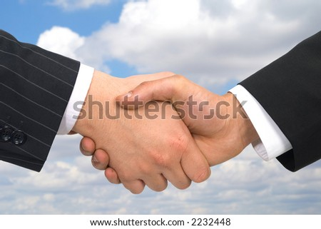 business handshake on clouds background, both files are from photographers portfolio