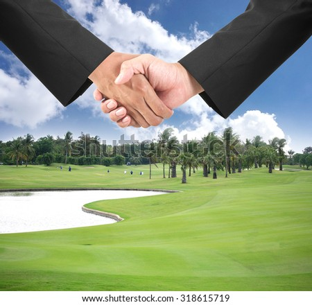 Business handshake on golf course - Contract concept. - stock photo