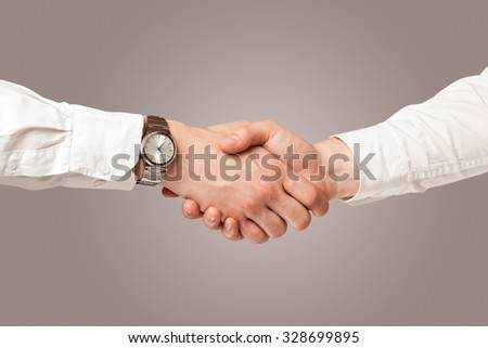 Business handshake on gradient background - stock photo