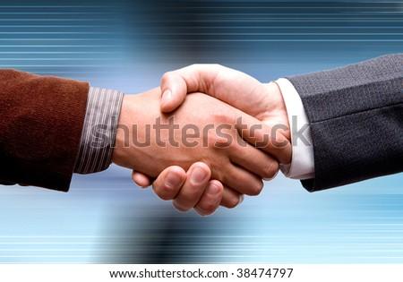 business handshake on technology background - stock photo