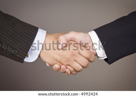 Business handshake on white background with clipping path. - stock photo
