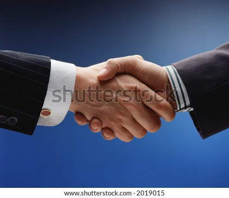business handshake over blue background - stock photo
