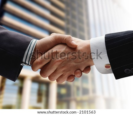 business handshake over blurry background - stock photo