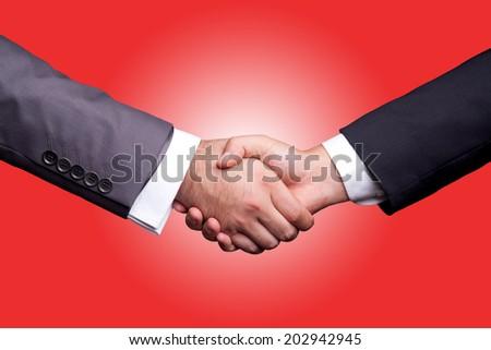 Business Handshake red background - stock photo