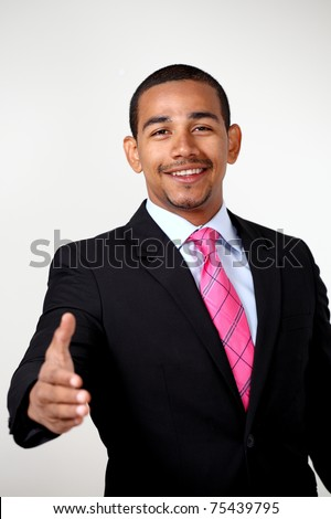 Business handshake, smiling confident man offers hand - stock photo