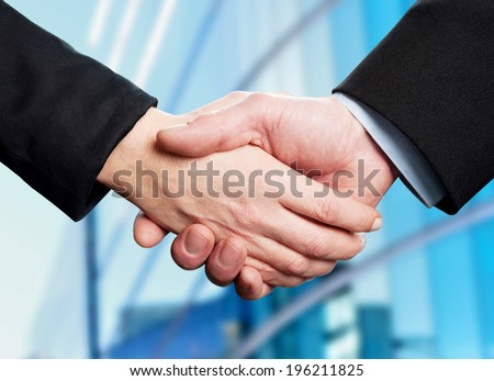Business handshake, the deal Is finalized. - stock photo