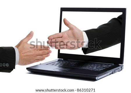 Business handshake through a laptop screen - stock photo
