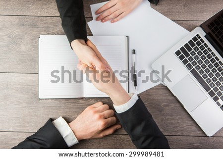 Business handshake. Top view.  empty white space you can put your text - stock photo