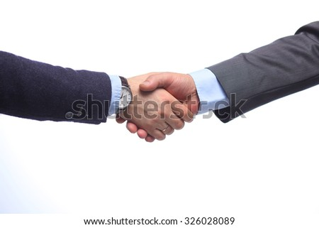 Business handshake. Two businessman shaking hands with each other in the office
