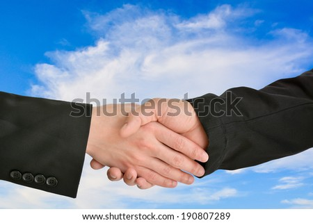 Business handshake with cloud in the blue sky