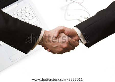 Business handshake with laptop computer