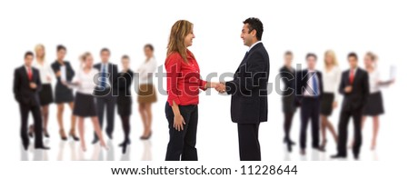 business handshake with lots of business people on white background - stock photo